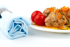 Blue cloth napkin and a plate of meat balls Stock Photo