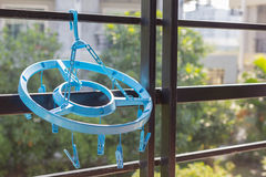 Blue clothes hanger for underpants and socks Stock Image