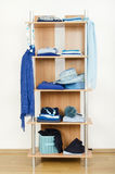 Blue clothes nicely arranged on a shelf. Royalty Free Stock Photography