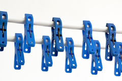 Blue clothespins on a string Royalty Free Stock Photo