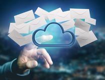 Blue cloud surrounded by realistic envelope email displayed on a Royalty Free Stock Photo