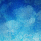 Blue Cloud Watercolor Paper. Blue and white watercolor clouds on wrinkled paper Royalty Free Stock Photos