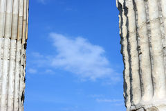 Blue clouded sky between two ancient Greek columns Royalty Free Stock Photography