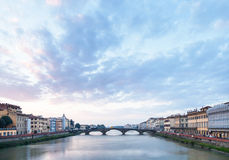 Blue clouds over Arno River and Ponte alla Carraia Stock Image