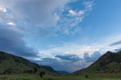 Blue clouds over the hidden valley Royalty Free Stock Images