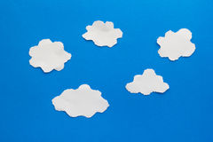 Blue clouds paper craft artwork. Blue clouds paper torn craft royalty free stock image