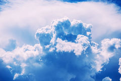 Blue clouds and sky Stock Photos