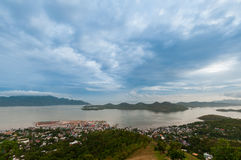 Blue clouds and sky over small village Coron at Royalty Free Stock Photography