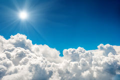 Blue clouds, sun and sky. Blue clouds and sky and shining sun. Natural cloudscape background Stock Photos