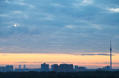 Blue clouds and yellow sunrise sky over city Stock Photography