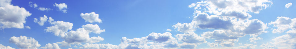 Blue cloudy sky. Panorama of the blue cloudy sky Stock Photo