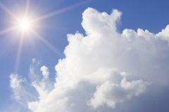 Blue cloudy sky. More dark blue cloudy sky and bright sun Royalty Free Stock Photo