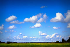 Blue cloudy sky. And northern German landscape royalty free stock photos