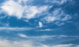 Blue cloudy sky. A background of a cloudy blue sky Stock Photos