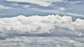 Blue cloudy sky Stock Images