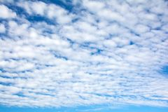 Beautiful clearing clouds on a blue sky royalty free stock photo