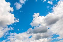 Beautiful clearing clouds on a blue sky royalty free stock images