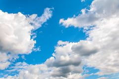 Beautiful clearing clouds on a blue sky royalty free stock image
