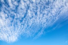 Beautiful clearing clouds on a blue sky stock images