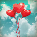 The blue cloudy sky with balloons, as background. The blue cloudy sky with balloons, as valentines background Royalty Free Stock Images