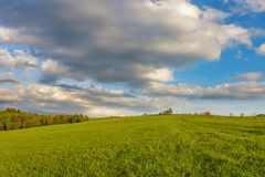 Blue cloudy sky over green hills. Bieszczady mountain range, Poland royalty free stock images