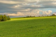 Blue cloudy sky over green hills and distant trees. Bieszczady mountain range, Poland stock images