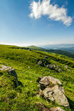Blue cloudy sky over the mountains with rocky hillside. Cloudy blue sky over the mountains with rocky hillside. gorgeous nature of Carpathian mountains Stock Photography