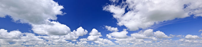 Blue cloudy sky panorama Stock Photos