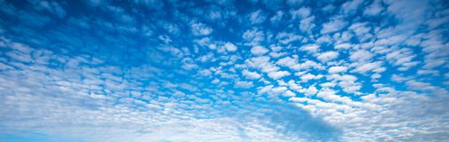 Blue cloudy sky panorama. Panoramic image of blue cloudy sky royalty free stock photo