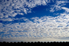 Blue cloudy sky Stock Photos