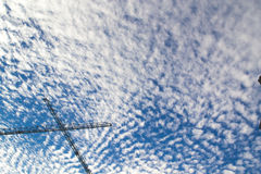 Blue cloudy sky with scaffold. In summer time stock photo