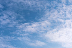 Blue and cloudy sky. Small white clouds against blue sky in spring Stock Photography