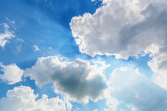 Blue cloudy sky with sun rays. Background of blue cloudy sky with sun rays Stock Images