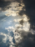 Blue cloudy sky with sunbeams Royalty Free Stock Photos