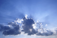 Blue cloudy sunburst sky Royalty Free Stock Images