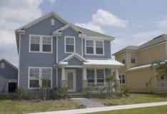 Blue coastal home. Florida coastal style home with tin roof and white trim stock photo