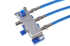 Blue coaxial cables with tv splitter Royalty Free Stock Images