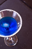 Blue cocktail. Blue liquid in cocktail glass with salted rim Stock Photography