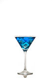 Blue cocktail. Blue drink   in a cocktail or martini glass with ice Royalty Free Stock Photography