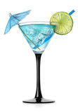 Blue cocktail. In a glass on a white background royalty free stock photo