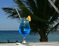 Blue cocktail. An inviting tropical blue cocktail Stock Photos