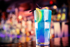 Blue cocktail on the bar. Blue curacao cocktail on the bar stock photo