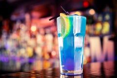 Blue cocktail on the bar. Blue curacao cocktail on the bar Stock Photo