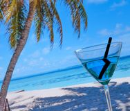 Blue cocktail on beach Royalty Free Stock Photos