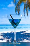 Blue cocktail on beach on wood table Stock Images