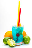 Blue cocktail with cherries, mango, orange, lime, grapefruit on an isolated background Royalty Free Stock Images