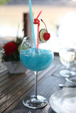 Blue cocktail with cherry and lime , kamikaze Royalty Free Stock Photography