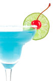 Blue cocktail with cherry and lime slice Stock Images