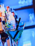 Blue cocktail drink on a bar table Stock Photo