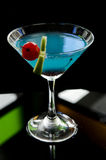 Blue cocktail drink with cherry and lime Stock Photos